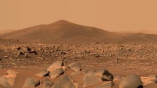 """NASA's Perseverance Mars rover used its dual-camera Mastcam-Z imager to capture this image of """"Santa Cruz,"""" a hill about 1.5 miles away from the rover, on April 29, 2021, the 68th Martian day, or sol, of the mission. The entire scene is inside of Mars' Jezero Crater; the crater's rim can be seen on the horizon line beyond the hill. (Credit: NASA / JPL-Caltech / ASU / MSSS)"""