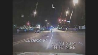 A still image from police dashcam footage that captured the shooting of Laquan McDonald, center, on a Southwest Side street in 2014.