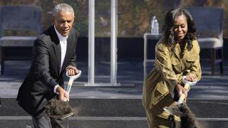 Former President Barack Obama, left, and former first lady Michelle Obama toss shovels of dirt during a groundbreaking ceremony for the Obama Presidential Center Tuesday, Sept. 28, 2021, in Chicago. (AP Photo / Charles Rex Arbogast)