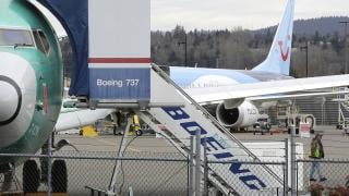 In this photo taken Monday, March 11, 2019, a Boeing 737 MAX 8 airplane being built for TUI Group sits parked in the background at right at Boeing Co.'s Renton Assembly Plant in Renton, Washington. (AP Photo / Ted S. Warren)