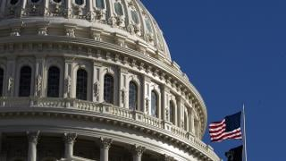The U.S. flag flies over the U.S. Capitol in Washington on Sunday, Jan. 19, 2020. (AP Photo / Manuel Balce Ceneta)