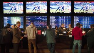 In this Thursday, Dec. 13, 2018, file photo, gamblers place bets in the temporary sports betting area at the SugarHouse Casino in Philadelphia. (AP Photo / Matt Rourke, File)