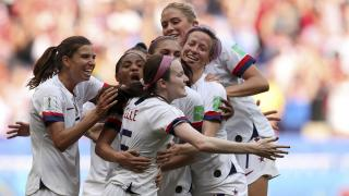 United States' Rose Lavelle, center, celebrates after scoring her side's second goal during the Women's World Cup final soccer match between U.S. and The Netherlands at the Stade de Lyon in Decines, outside Lyon, France, on Sunday, July 7, 2019. (AP Photo / Francisco Seco)