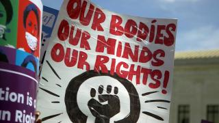 Abortion rights protesters hold signs at a rally in this file photo. (WTTW News)
