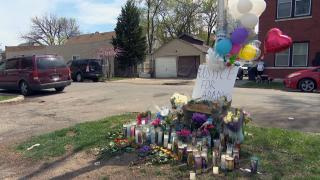 A memorial of candles and flowers for 13-year-old Adam Toledo sits near the alley where he was killed March 29 by a Chicago police officer. (WTTW News)