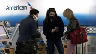 Travelers wear masks at the airport in this file photo. (WTTW News)