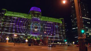 Art on the Mart's unique location — projected across the massive face of the building formerly known as The Merchandise Mart, makes for optimal views whether you're walking or driving. (WTTW News)