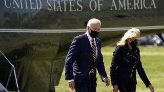 President Joe Biden walks from Marine One with first lady Jill Biden on the Ellipse on the National Mall after spending the weekend at Camp David, Monday, April 5, 2021, in Washington. (AP Photo / Evan Vucci)
