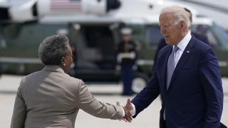 President Joe Biden greets Chicago Mayor Lori Lightfoot as he arrives at O'Hare International Airport, Wednesday, July 7, 2021, in Chicago. (AP Photo / Evan Vucci)
