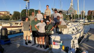 Producer Jay Shefsky and cameraman Felix Mendez pose with the crew of Mise en Place at Jackson Park Harbor.