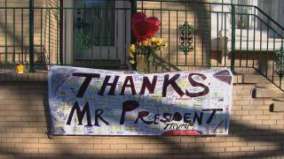 A banner on the Chicago home of Rod Blagojevich thanks President Donald Trump for commuting the former governor's 14-year prison sentence. (WTTW News)