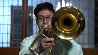 Rafael Noriega performs on the bass trombone, Feb. 1 2021. (WTTW News)