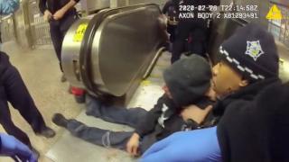 Chicago police officers respond to Ariel Roman, who is seated on the ground moments after he was shot by a different officer inside the Grand Red Line station on Feb. 28, 2020. (Civilian Office of Police Accountability)