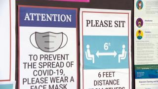 In this file photo, COVID-19 health and safety signs are posted. (WTTW News)