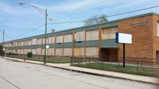 The former Attucks Elementary School building, located near Washington Park, is one of the 50 schools CPS closed in 2013. (Steven Kevil / Wikimedia Commons)