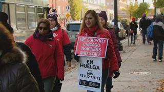 Striking Chicago Public Schools teachers carry signs on Monday, Oct. 28, 2019, day eight of the Chicago teachers strike. (WTTW News)
