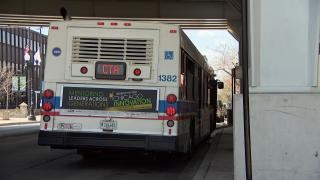 A CTA bus picks up passengers in Chicago. (WTTW News)