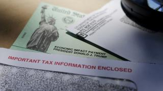 In this April 23, 2020, file photo, President Donald Trump's name is seen on a stimulus check issued by the IRS to help combat the adverse economic effects of the COVID-19 outbreak, in San Antonio. (AP Photo / Eric Gay, File)