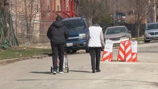 A couple walks along a street in Chicago's Chatham neighborhood on Monday, April 6, 2020. (WTTW News)