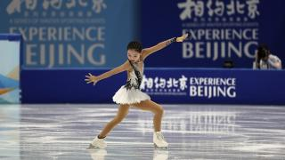Chinese figure skater Xu Jingyu performs her women's single skating short program during a test event for the 2022 Beijing Winter Olympics at the Capital Indoor Stadium in Beijing, Sunday, April 4, 2021. (AP Photo / Andy Wong)