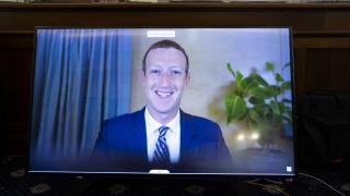Facebook CEO Mark Zuckerberg appears on a screen as he speaks remotely during a hearing before the Senate Commerce Committee on Capitol Hill, Wednesday, Oct. 28, 2020, in Washington. (Michael Reynolds / Pool via AP)