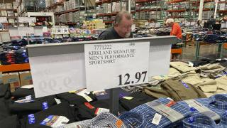 A sign displays the price for shirts as a shopper peruses the offerings at a Costco warehouse on Thursday, June 17, 2021, in Lone Tree, Colo. (AP Photo / David Zalubowski)