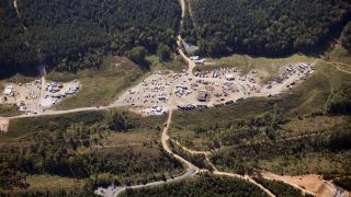 In this Sept. 20, 2016 file photo vehicles are seen near Colonial Pipeline in Helena, Ala. (AP Photo / Brynn Anderson, File)