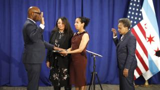 David Brown is sworn in as police superintendent by Chicago Mayor Lori Lightfoot after unanimous approval by the Chicago City Council on Wednesday, April 22, 2020. Brown's wife and daughter are also pictured. (@Chicago_Police / Twitter photo)