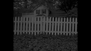 """Dawoud Bey. """"Untitled #1 (Picket Fence and Farmhouse),"""" from the series """"Night Coming Tenderly, Black,"""" 2017. Rennie Collection, Vancouver. © Dawoud Bey."""