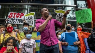 Housing advocate Jabari Brisport protests outside Gov. Andrew Cuomo's office on the eviction moratorium on Wednesday, Aug. 4, 2021, in New York. (AP Photo / Brittainy Newman)