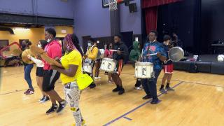 Hope Junior Drumline and WestDance have been practicing three hours a day, five days a week since late June to prepare for their performance at Lollapalooza. (WTTW News)