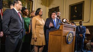 Gov. J.B. Pritzker addresses a new bill to raise the state's minimum wage to $15 an hour on Thursday, Feb. 7, 2019. (Justin L. Fowler/The State Journal-Register via AP)