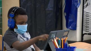 In this file photo, a young student wears a mask indoors. (WTTW News)