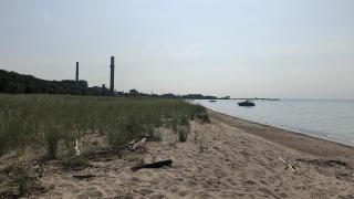 Indiana Dunes National Park, with various industrial plants in the background, in 2019. (Patty Wetli / WTTW News)