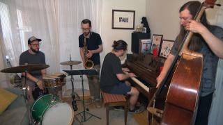 Chicago-based musician Juan Pastor, left, plays the cajon with his band Chinchano. (WTTW News)
