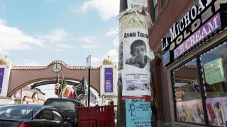 A flyer with the name and face of Adam Toledo, the 13-year-old boy who was fatally shot by a Chicago police officer on March 29, is shown on a lamppost in the Little Village neighborhood, where he lived and died. (WTTW News)