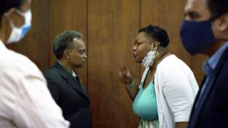 Mayor Lori Lightfoot, left, listens as Ald. Jeanette Taylor (20th Ward) responds to her request to allow the Chicago City Council to vote to confirm Celia Meza as the city's top lawyer at a City Council meeting Wednesday, June 23, 2021. (WTTW News)
