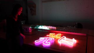 Neon artist Audra Jacot lights up one of her works at the School of the Art Institute of Chicago's Light Lab.