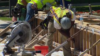 Temperatures have been reaching record breaking levels across the country — affecting working conditions for farmers, those in construction, and even delivery workers. (WTTW News)