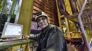 In this 2018 photo made available by CERN, Nikolai Bondar works on the LHCb Muon system at the European Organization for Nuclear Research Large Hadron Collider facility outside of Geneva. (Maximilien Brice, Julien Marius Ordan / CERN via AP)