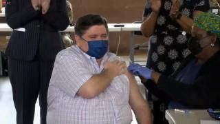 Gov. J.B. Pritzker receives the Johnson & Johnson COVID-19 vaccine on Wednesday, March 24, 2021 at a mass vaccination site in Springfield. (WTTW News)