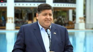 """Speaking from Six Flags Great America, Gov. J.B. Pritzker gives Illinoisans """"more incentive to get vaccinated,"""" as the state moves into the bridge phase of reopening, and venues announce their summer plans, May 13, 2021. (WTTW News)"""