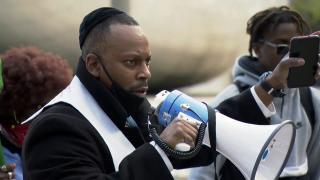 Rabbi Michael Ben Yosef of the Chicago Activist Coalition For Justice speaks during a demonstration in Millennium Park on Thursday, April 15, 2021. (WTTW News)