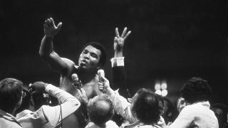 Muhammad Ali talks with the press after winning back the Heavyweight Championship for an unprecedented third time by beating Leon Spinks at the Super Dome in New Orleans, LA. Sept. 15, 1978. (Courtesy of Michael Gaffney)