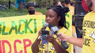 Adwoa Agyepong of the Chicago Democratic Socialists of America speaks at a rally to end the city's use of ShotSpotter technology on Thursday, Aug. 19, 2021. (WTTW News)
