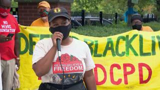 People speak out against the city's use of ShotSpotter technology at a rally on Thursday, Aug. 19, 2021. (WTTW News)
