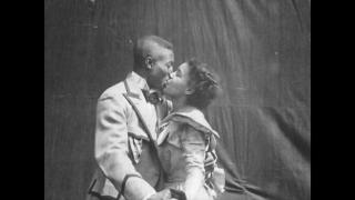 """A still image from the 1898 silent film """"Something Good-Negro Kiss."""""""