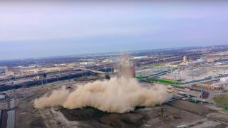 A still image taken from a video showing the demolition of the Crawford Power Generating Station smokestack in Little Village on Saturday, April 11, 2020. (Alejandro Reyes / YouTube)