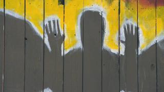 A mural near a memorial for Adam Toledo. (WTTW News)