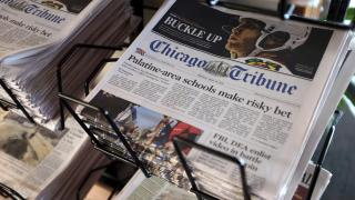 In this Monday, April 25, 2016, file photo, Chicago Tribune and other newspapers are displayed at Chicago's O'Hare International Airport. (AP Photo / Kiichiro Sato, File)